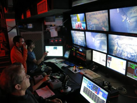 The ROV piloting team inside 'mission control', photo by Claudio